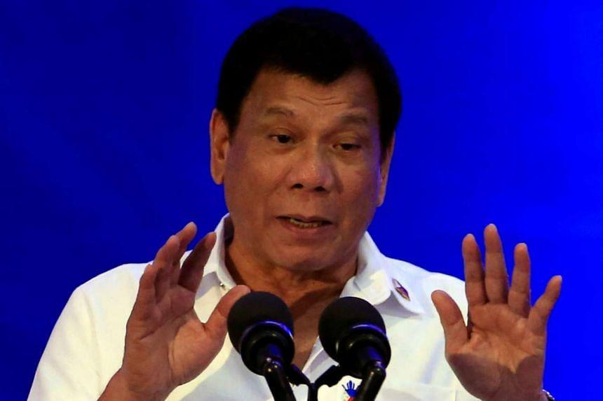 Philippine President Rodrigo Duterte delivers a speech during the 80th National Bureau of Investigation founding anniversary at its headquarters in metro Manila on Nov 14, 2016.