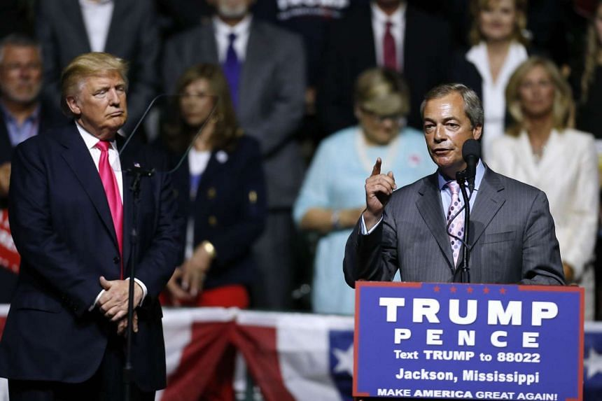 Nigel Farage (right) speaks at Donald Trump's campaign rally in Mississippi on Aug 24, 2016.