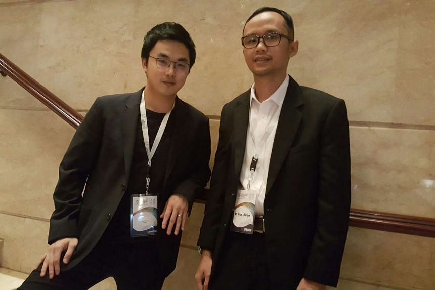 Mr Paul Teng (left), CEO of SixCap, and Dr Trias Aditya from Gadjah Mada University. SixCap and Gadjah Mada University have been working together to develop a mobile app to crowdsource haze data.