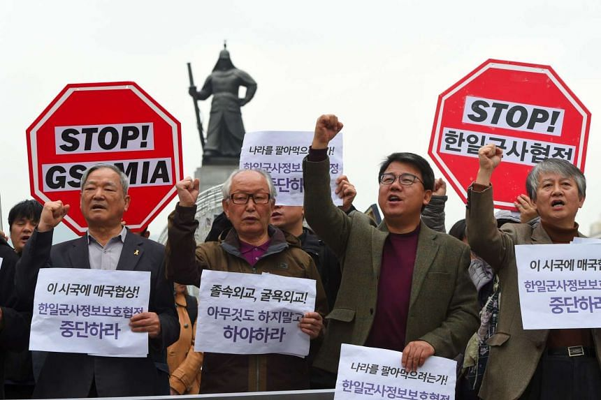 South Korean protesters shout slogans during a rally against a planned preliminary signing of the General Security of Military Information Agreement between South Korea and Japan, in Seoul on Nov 14, 2016.