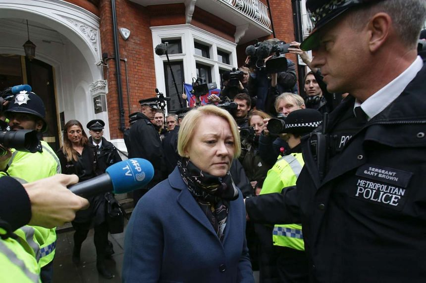 Swedish prosecutor Ingrid Isgren (centre) leaves the Ecuadorian Embassy in London on Nov 14, 2016 where Julian Assange was being questioned over a rape allegation against him.