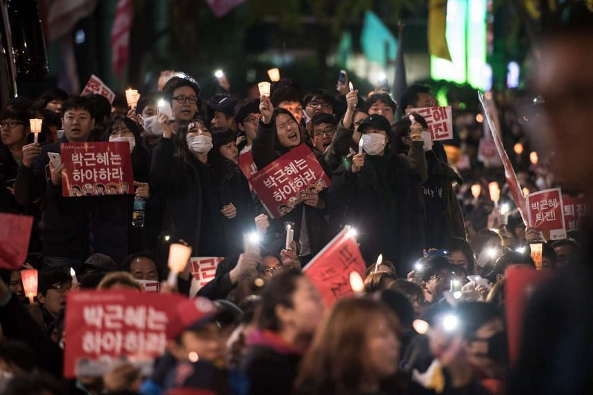 Protesters call for the resignation of South Korean President Park Geun Hye during an anti-government protest in central Seoul on Nov 12, 2016.