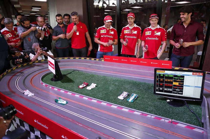 Formula One racing drivers Marc Gene (4th from right), Sebastian Vettel (3rd from right), and Kimi Raikkonen (2nd from right), along with Brazilian former soccer player Kaka (right) of Ferrari team at Interlagos in Sao Paulo, Brazil, on Nov 10, 2016.