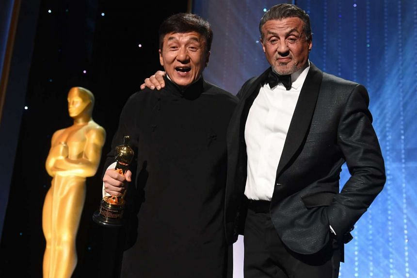 Martial arts star Jackie Chan poses with Sylvester Stallone after accepting his honorary Oscar at the 8th Annual Governors Awards in Hollywood, California.