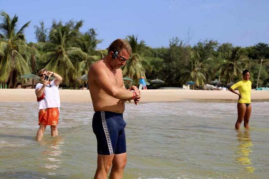 Ben Hooper, 38, adjusts his watch before starting a swim across the Atlantic from Dakar, Senegal, on Nov 13, 2016.