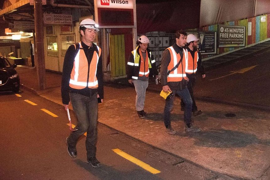 City engineers inspect buildings in the central business district in Wellington on early Nov 14, 2016, following an earthquake north of New Zealand's South Island city of Christchurch.