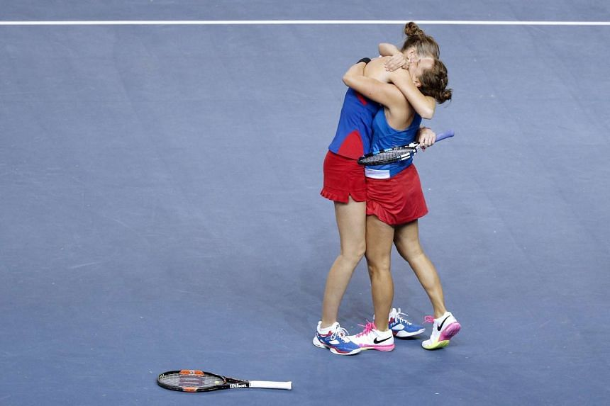 Barbora Strycova (right) and Karolina Pliskova (left) of Czech Republic celebrate winning against Caroline Garcia and Kristina Mladenovic of France during the Fed Cup Tennis World Group final between France and the Czech Republic at the Rhenus Sport