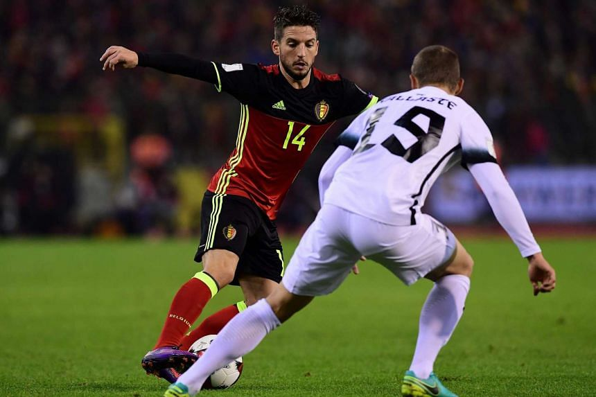 Belgium's Dries Mertens (left) vies for the ball with Estonia's Ken Kallaste during the World Cup 2018 football qualification match between Belgium and Estonia on Nov 13, 2016 at the King Baudouin Stadium in Brussels.