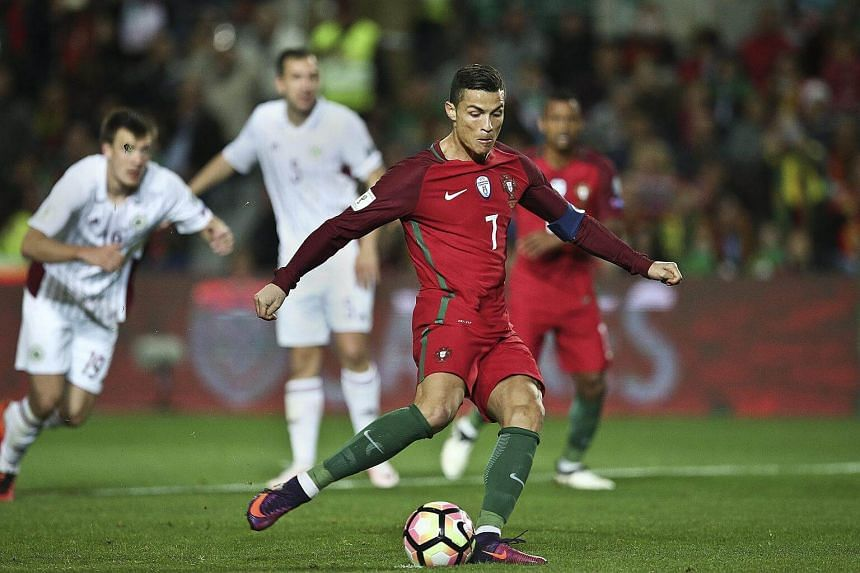 Portugal's player Cristiano Ronaldo misses a penalty during the Fifa World Cup 2018 qualifying soccer match at Algarve Stadium, in Faro, Portugal, on Nov 13, 2016.