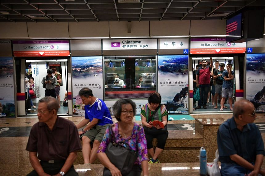 Commuters waiting at Chinatown station.