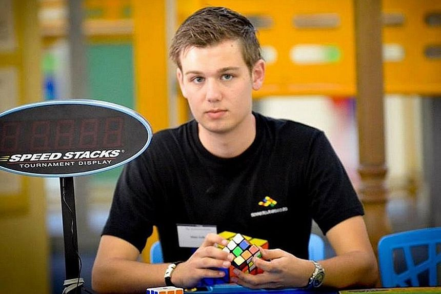 Dutch student Mats Valk has set a new world record to solve a 3x3 Rubik's Cube - 4.74 seconds. Seen here in a 2014 photo, he is now on exchange at Nanyang Technological University until next month.