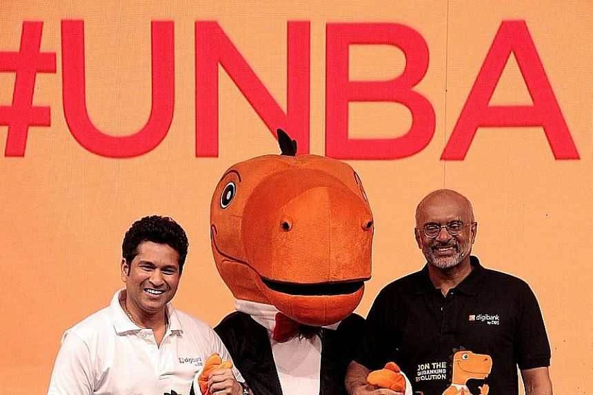 Former Indian cricketer Sachin Tendulkar (far left) with DBS chief executive Piyush Gupta at the launch of digibank in India. Above: In May, DBS launched digibank, India's first mobile-only bank.