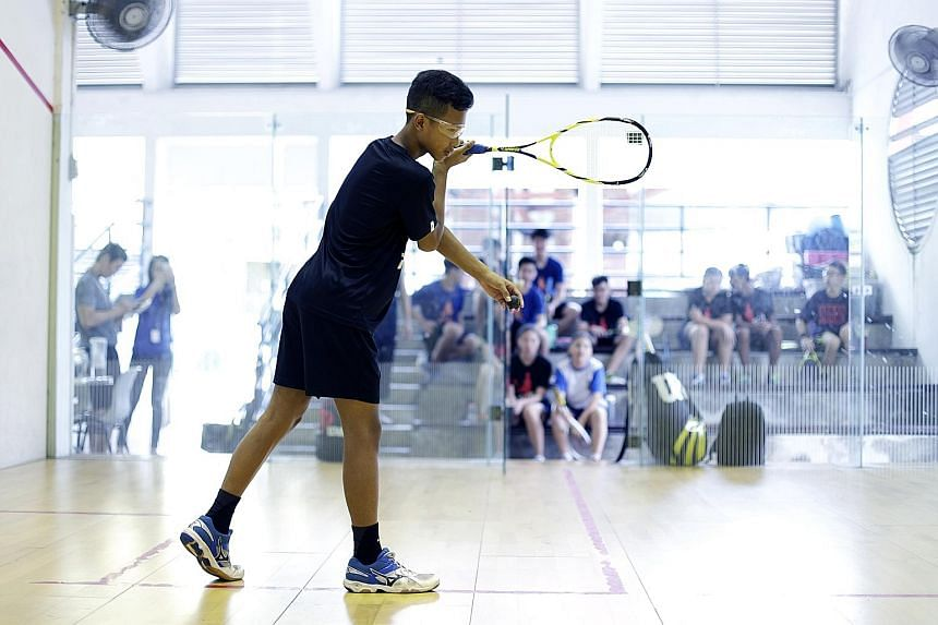 Muhammad Ridwan Kamsani, a member of the school's squash team. Outram Secondary School has a squash complex which houses two courts.