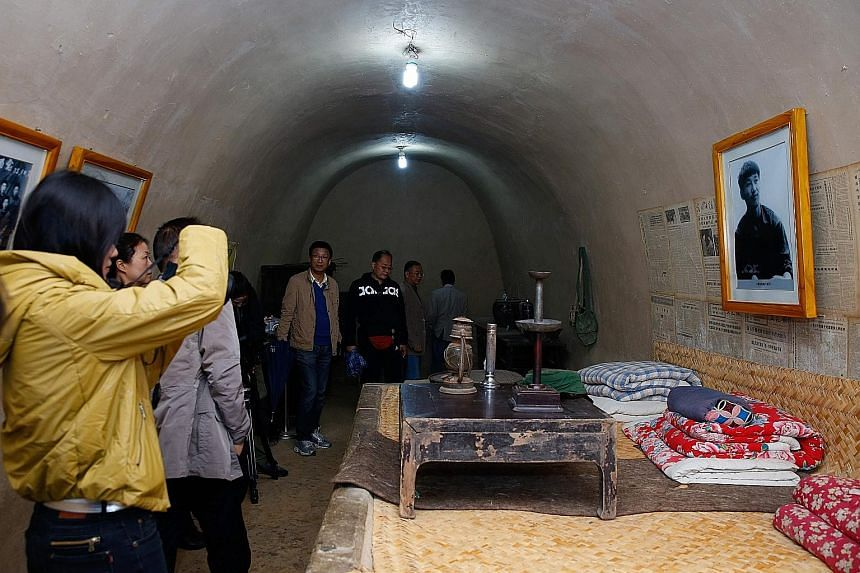 Tourists in the caves in the remote village of Liangjiahe where Mr Xi Jinping was sent during the Cultural Revolution.