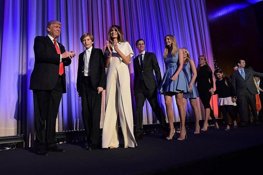 On election night, Mr Donald Trump wore his usual dark suit and red tie while Mrs Melania Trump wore a white Ralph Lauren jumpsuit, which she had bought off the rack.