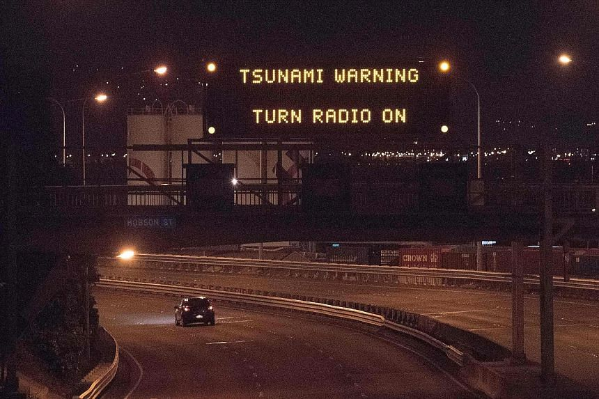 A noticeboard above State Highway 1 in Wellington displaying a tsunami warning alert. The powerful earthquake was centred some 90km north of the South Island city of Christchurch and felt throughout the country. Although no injuries were reported, th