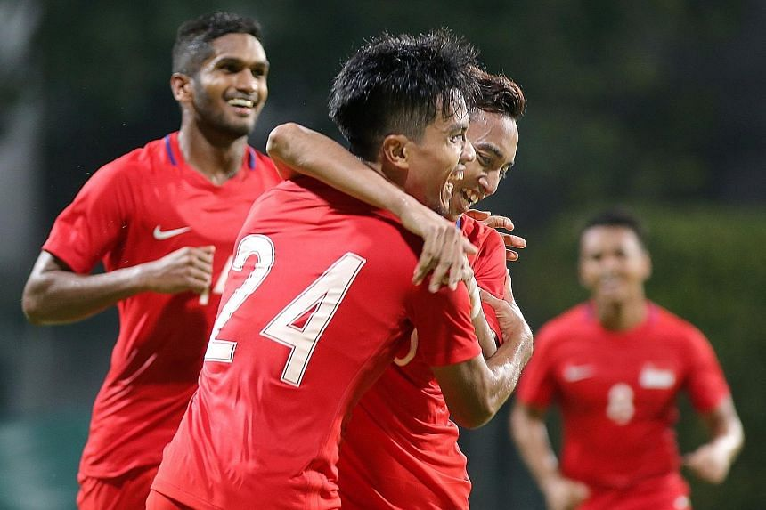Yasir Hanapi (centre, no 24) celebrates his goal with Faris Ramli (second from right) and Hariss Harun (left) in the 1-0 victory against Cambodia last night. The strike was the first international goal of Yasir's career.