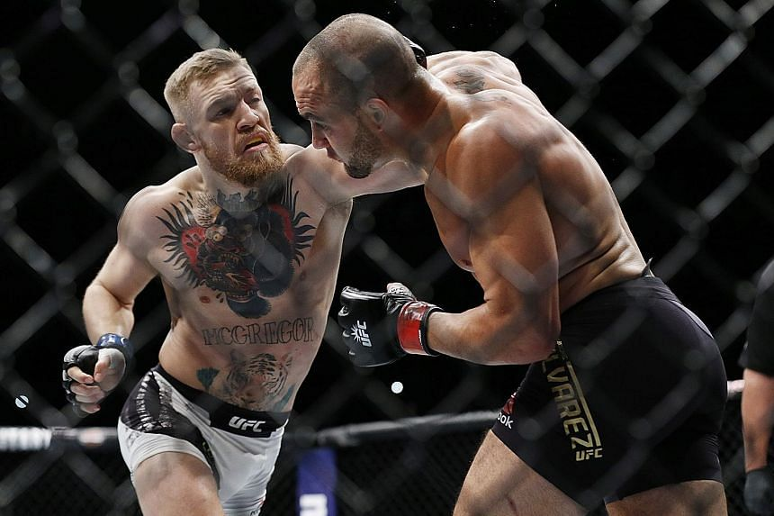 Conor McGregor (left) fighting Eddie Alvarez in their lightweight title bout during UFC 205 at Madison Square Garden on Saturday. McGregor won to improve to 21-3 in MMA competition and 9-1 in UFC.
