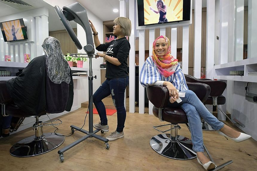 Ms Nura at her women-only hair salon, Pearlista, in Clementi. The lack of such salons for Muslim women who wear headscarves prompted her to open her own in 2014.