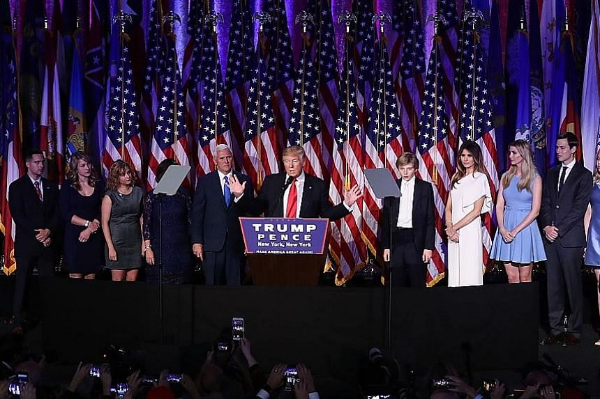 Mr Trump giving his victory speech in New York last Wednesday, with Vice-President-elect Mike Pence and their families. Most Asian markets and emerging market currencies finished the week beaten down, amid uncertainty over the impact of a Trump presi