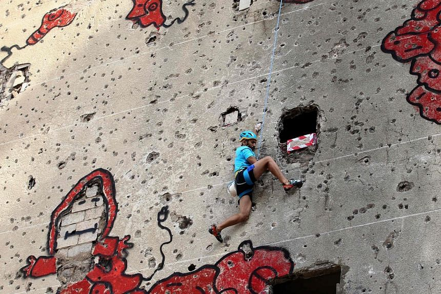 In an effort to transform war-torn buildings into climbing challenges, Beirut's Al-Kamal building became the site of an urban climbing competition on Saturday. The building was severely damaged during the Lebanese civil war from 1975 to 1990, with it