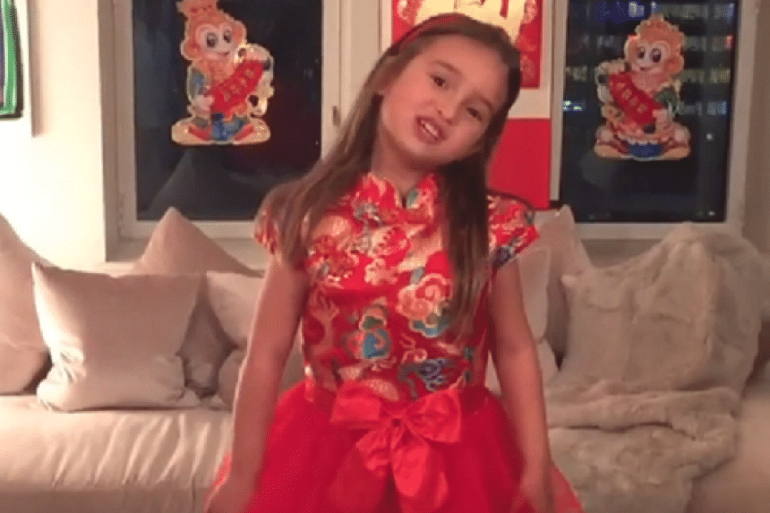 In the video, Arabella appears wearing a traditional qipao and stands on a table to recite works by famed Chinese poets such as Li Bai.