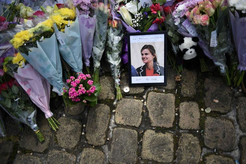This file photo taken on June 18, 2016 shows a photograph of slain Labour MP Jo Cox sitting among flowers left in tribute to her in Birstall, northern England following her murder on June 16. The trial of the man accused of murdering Labour MP Jo Cox
