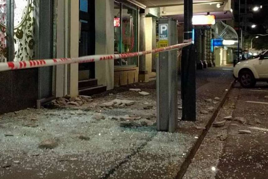 Shattered windows are seen outside shops after a 7.8-magnitude earthquake hit New Zealand on Sunday (Nov 13).