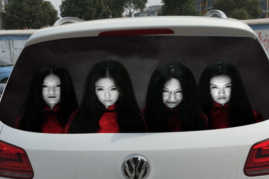 Some drivers in China are turning to scary car decals to deter other motorists from using high beam headlights.