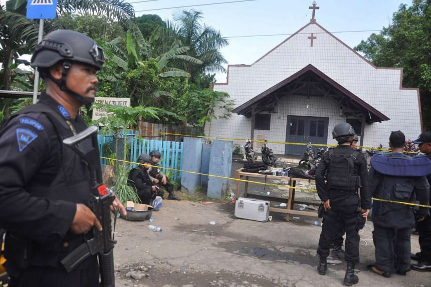 Police standing near the scene of an explosion outside a church in Samarinda, East Kalimantan, Indonesia, on Nov 13, 2016, in this photo taken by Antara Foto.