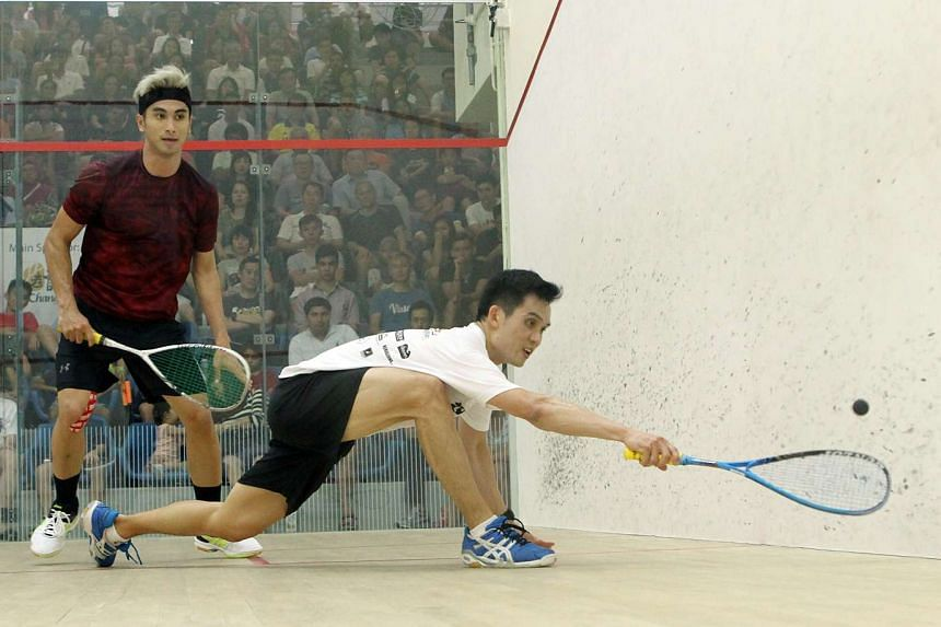 Malaysia's Ong Beng Hee (in white) seeing off compatriot Valentino Bong 3-2 in the Men's Premier final of the Old Chang Kee Singapore Open on Dec 20, 2015.