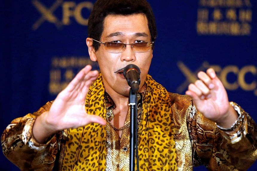 Japanese singer and song writer Pikotaro performs before media at a news conference in Tokyo on Oct 28, 2016.