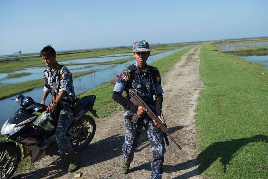 Armed Myanmar border guard patrol the border area along the river dividing Myanmar and Bangladesh located in Maungdaw, Rakhine State on Oct 15, 2016.