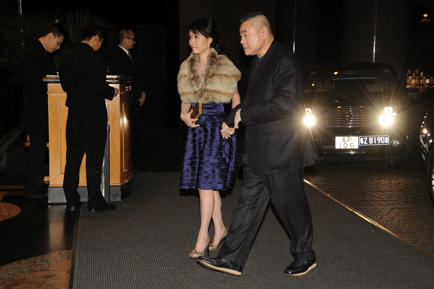 Joseph Lau and his then partner Yvonne Lui attending an event hand in hand in 2012.