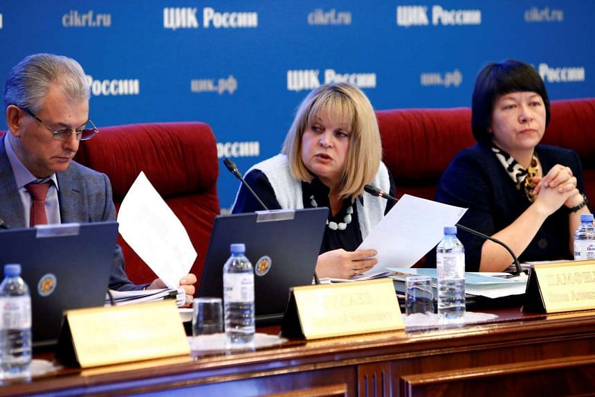 Head of the Central Election Commission Ella Pamfilova (C) speaks at a session of the commission dedicated to violations during the recent parliamentary election in Moscow, Russia, Sept 21, 2016.