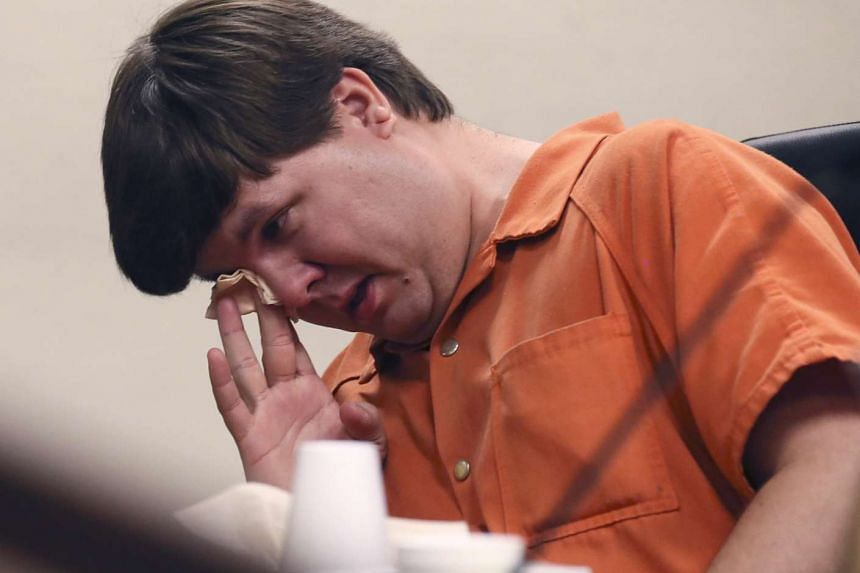Justin Ross Harris, arrested for allegedly leaving his young son in a hot car resulting in his death, wipes away tears at a bail hearing in Cobb County Magistrate Court in Marietta, Georgia July 3, 2014.