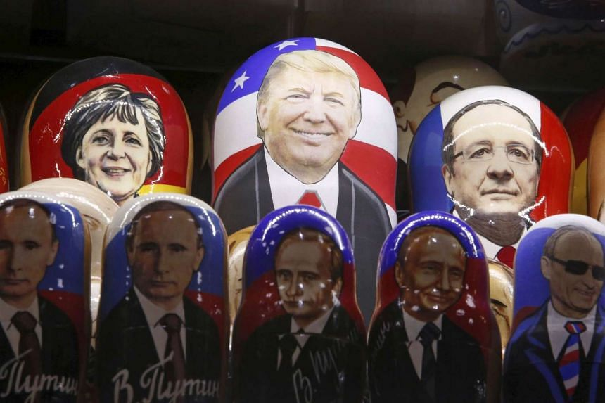 Painted Matryoshka dolls, or Russian nesting dolls, bearing the faces of US Republican presidential nominee Donald Trump, German Chancellor Angela Merkel, French President Francois Hollande and Russian President Vladimir Putin are displayed for sale