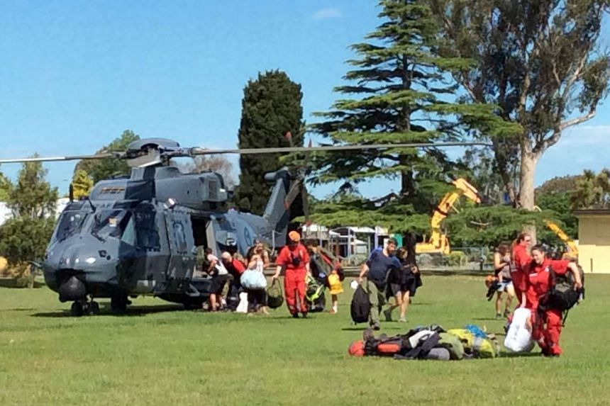 A helicopter landing at Woodend after evacuating some of the 1,200 of tourists from Kaikoura.