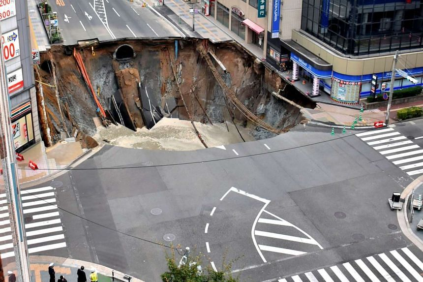 The gigantic sinkhole, measuring around 30m wide and 15m deep, appeared last Tuesday in a bustling business district in Fukuoka.