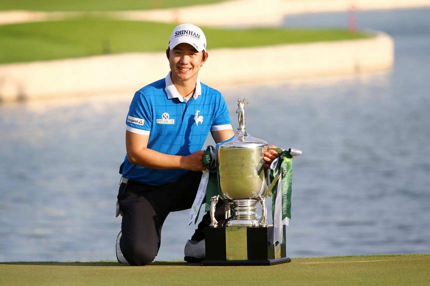 South Korean golfer Song Young Han with the champion trophy of the 2016 SMBC Singapore Open at Sentosa Golf Club's Serapong Course on Feb 1, 2016.