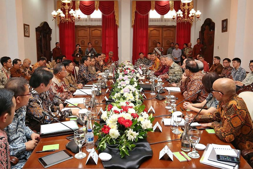 PM Lee and President Joko and their respective delegations at Wisma Perdamaian in Semarang, Indonesia yesterday. Both leaders also announced that Singapore and Indonesia will celebrate the 50th anniversary of diplomatic relations next year.