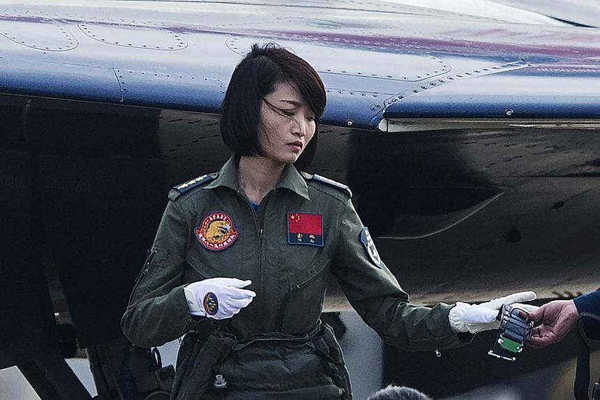 Capt Yu Xu, seen here in a picture taken in November 2014, was the first Chinese woman to fly a J-10 fighter jet. She died in a training accident.