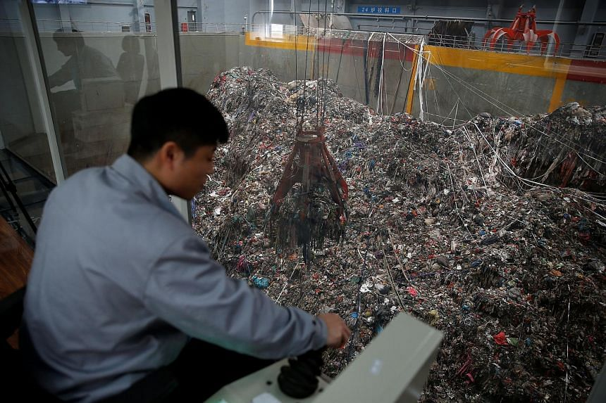 A worker at the new waste-to-energy plant in Wujiang, Jiangsu province, built by China Everbright. The plant is designed to burn 1,500 tonnes of rubbish every day.