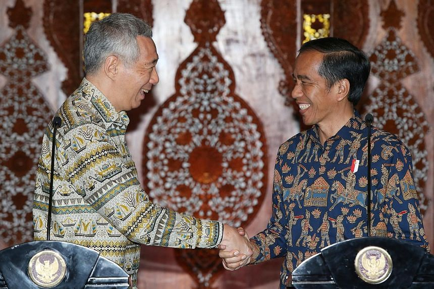 PM Lee with President Joko at a joint press conference at Wisma Perdamaian in Semarang, Indonesia, yesterday. At their meeting, the two leaders reaffirmed their commitment to strengthening ties and to further economic cooperation between their countr
