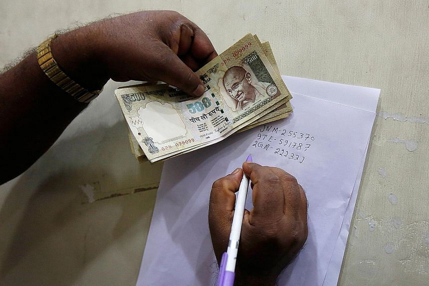 India has withdrawn 500- and 1,000-rupee notes from circulation, resulting in long queues of people depositing old bills across the country. Mr Modi defended the move as an important step to fight corruption.