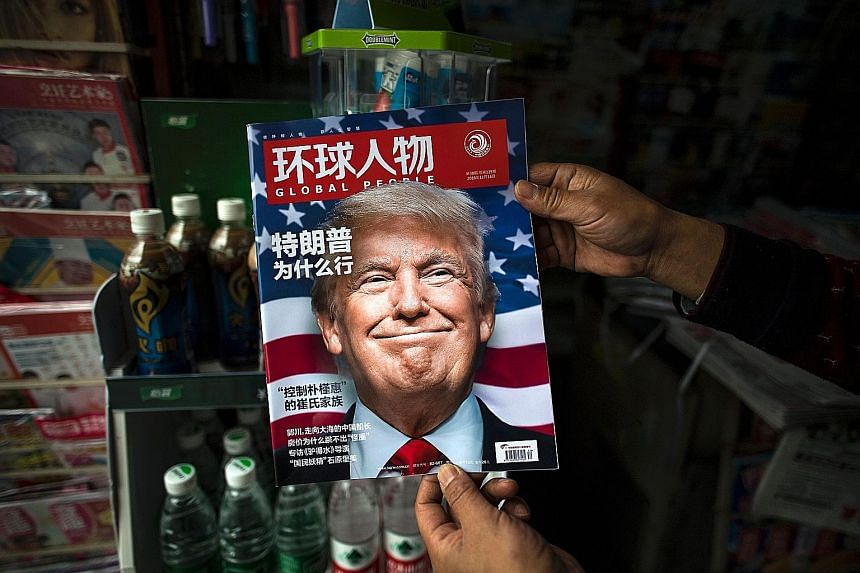 A copy of Chinese magazine Global People with a cover picture of Mr Trump at a news-stand in Shanghai. During his presidential campaign, Mr Trump accused China of manipulating its currency and vowed to put a 45 per cent tariff on all Chinese goods -