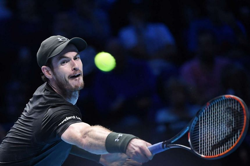Andy Murray celebrated his rise to the top of the world rankings with a 6-3, 6-2 victory over Marin Cilic on Monday as the Scot made a strong start to his bid to win the ATP Tour Finals.