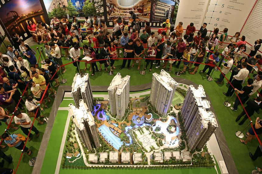 Buyers and their agents queueing to book a unit at High Park Residences on July 17, 2015.