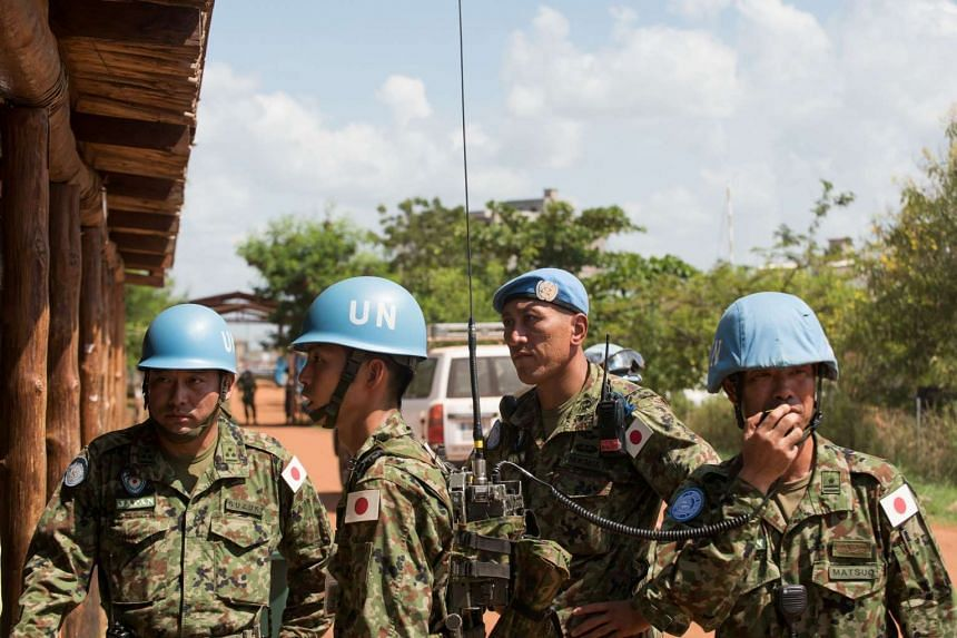 Japanese soldiers on United Nations peacekeeping operations await the arrival of Defence Minister Tomomi Inada at a military base in Tomping Juba, South Sudan, on Oct 8, 2016.