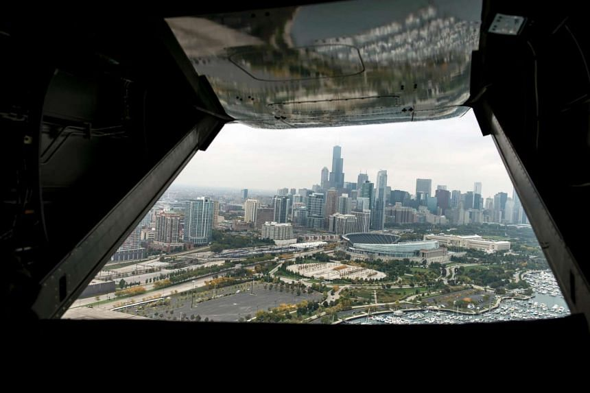 """This file photo taken on October 2, 2014 shows downtown Chicago seen from a helicopter in Chicago, Illinois. Chicago on November 14, 2016 joined several major US cities in affirming that it will remain a """"sanctuary city"""" for immigrants, in defiance o"""